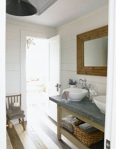 """Rustic Bathroom """"This bathroom console in the guesthouse was an antiques fair find,"""" says designer Ginger Barber. """"It all about the back and forth, crisp white vessel sinks and white walls against the worn zinc top and rustic baskets. Rustic Bathroom Designs, Bathroom Console, Best Bathroom Designs, Beautiful Homes, Simple Bathroom, Rustic Bathroom, Modern Vintage Bathroom, White Vessel Sink, Bathroom Design"""