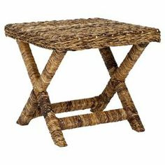 """Offer an extra seat to guests or display a tray of fresh cocktails on this wicker stool, featuring a crossed base and natural hue.    Product: StoolConstruction Material: WickerColor: NaturalFeatures: X-shaped designDimensions: 18.9"""" H x 20.9"""" W x 20.9"""" D"""