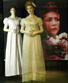 Image: Emma display case, with figures dressed in pale coloured cotton dresses in front of an image of Gwyneth Paltrow from the film