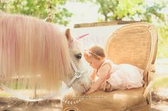Oh! How adorable, baby and horse in the soft sunlight. Unicorn mini session Www.1313photos.com