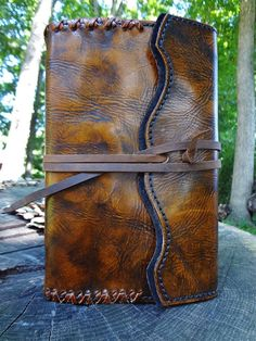 Rich Chestnut leather dyes and polished vegetable tanned leather combined with a classic whipstitched edging provides distinction for this custom journal. Black suede lining and refillable with your choice of Handmade or Lined paper selections.