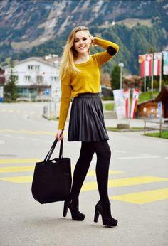 yellow sweatshirt, pleaded skirt, tights and boots