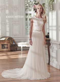 Patience Marie modest wedding dress by Maggie Sottero |Comprised of barely-there tulle, this stunning sheath wedding gown sparkles with a delicate Swarovski crystal belt at the waist. A flattering ruched bodice with feminine lace neckline and cap-sleeves is finished with crystal buttons over zipper and inner corset closure.