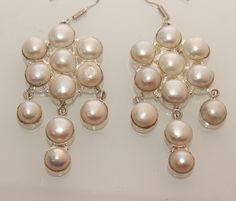 Holy White Pearl Exclusive High Demand Earrings. Starting at $1
