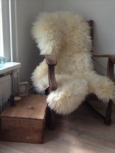 Old chair with a long haired sheepskin love it