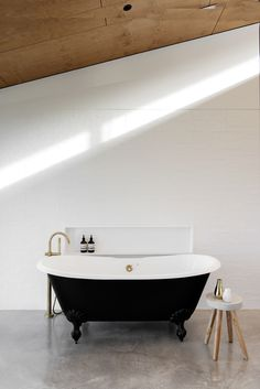 Looking for a timeless bathroom design? These classic black and white bathrooms exude elegance and style sure to last the ages. White Bathroom Interior, Black And White Tiles Bathroom, Black Bathtub, Bathroom Concrete Floor, Bathroom Flooring, Concrete Floors, Australian Interior Design, Interior Design Awards, Rustic Bathrooms