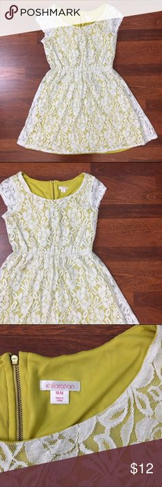 Xhilaration Lace Shortsleeve Dress Xhilaration Yellow & Laced White Shortsleeve Dress. Size Medium yet can fit Small too. Mustard yellow satin slip on the inside and white lace on the outside. Lace is in great condition; no frays. Zipper back detail. Cute dainty & delicate dress that can be dressed down with a denim jacket and sandals or dresses up with tights, booties, & peacoat. Xhilaration Dresses