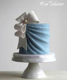 Elegant blue cake with white ribbon   Cake design by Eva Salazar