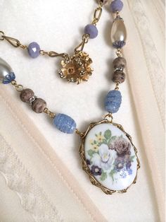 Blue Floral Vintage Necklace, Vintage Flower Brooch, Upcycled Assemblage Necklace, Blue Flower Necklace, Double Strand Necklace, OOAK by GlamourbillyDesigns on Etsy https://www.etsy.com/listing/401073087/blue-floral-vintage-necklace-vintage