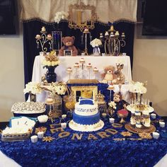 Royal theme baby shower. prince cake with crown. Royal blue and gold. . Candy buffet table. Dessert table.