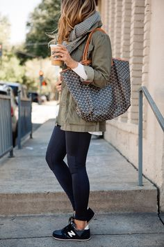 Army green utility jacket with workout leggings and sneakers
