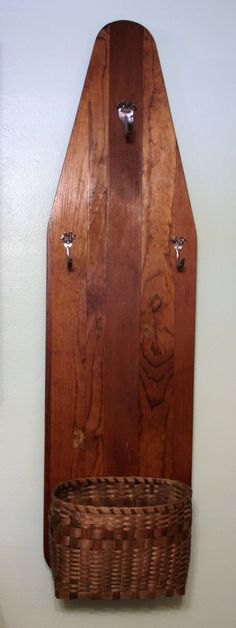 Wooden ironing board made into a coat/scarves/glove holder.