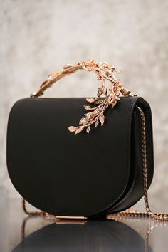 The Eden Eclipse Bag is part of an exclusive preview of our new Accessories collection, as featured in the AW16/17 Couture Show. For more information about the launch date and availability of this piece, please get in touch.: