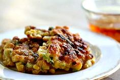 Zesty, spicy corn fritters, served with a sweet chili sauce. Step-by-step instructions with photos. From Simply Recipes. A great summer dinner Simply Recipes, Great Recipes, Favorite Recipes, Cheddar, Corn Fritter Recipes, Corn Recipes, Vegetable Recipes, Vegetarian Recipes, Cooking Recipes