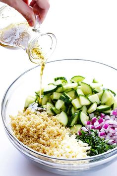 Love this Cucumber Quinoa Salad! It's super easy to make ahead of time, it's naturally gluten-free, and it's made with lots of fresh cucumber, feta, basil, red onion, and a simple lemon Italian vinaigrette. Perfect as a side or main dish! | gimmesomeoven.com
