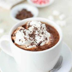 A combination of cocoa powder and chocolate chips make this hot chocolate extra flavorful and delicious! Ready in minutes. Hot Chocolate Recipe Easy, Homemade Hot Chocolate, Homemade Vanilla, Coconut Brownies, Hot Buttered Rum, Dessert Recipes, Fun Recipes, Popcorn Recipes, Easy Desserts