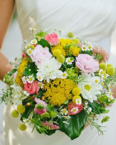 The pops of yellow in this bouquet make it extra cheery