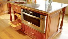 "Destiny: Manhattan Wide / Kitchen / E Gallery- The Manhattan Wide door style is one of several doors in the UltraCraft product line that features 3-1/2"" wide rail and stiles.  Manhattan Wide also features an applied molding detail, ogee profiling on both the inside and outside edges of the frame and a raised center panel.  A 5-piece drawer head is standard on this Traditionally styled door which is available in seven of the eight wood species offered."