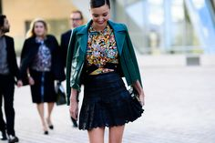 Find 47 perfect outfits for fall straight from Paris Fashion Week, like Miranda Kerr's colorful ensemble, now on wmag.com.