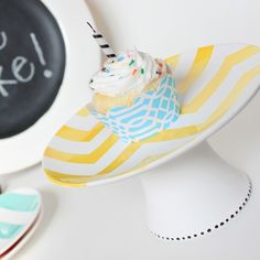 saw this on etsy for $50  but i could totally make: all i'd need is a cute plate, flower pot, some white paint and gorilla glue...sounds like a good weekend project