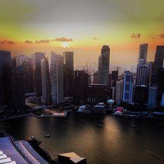 A beautiful sunset on the skyline of Singapore at Ku De Ta, Marina Bay Sands