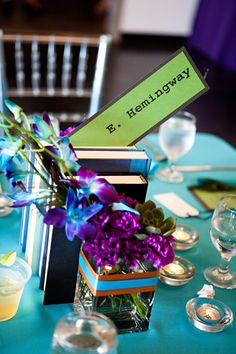 Book centerpieces with tables named after our favorite authors. Photo by emlifephoto.com.
