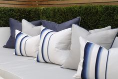 th2 Designs.© You can relax in the garden with these scatter cushions that add a linear pattern and shades of blues, to help cool those hot evenings.