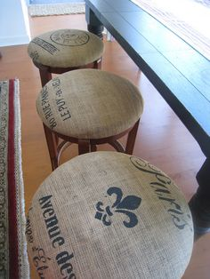 DIY French Grain Sack Bar Stools - Love this idea, use burlap and stencil yourself... > I love this idea; my mom had gorgeous cream color seats on her kitchen stools; which no matter how careful we were always seemed to get soiled, one way or another. I might just have to do this on them....?!