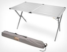 REI Camp Table XL - The individually adjustable legs also keep the table level on uneven ground, while supporting up to 120 lbs. The aluminum / steel legged heat-resistant slat top unfolds into a large-surfaced table perfect for all the pots, plates, grills and whatever else you need for that campsite party.