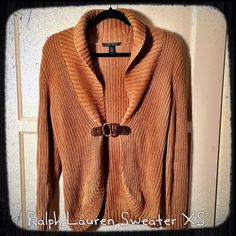 Camel Ralph Lauren Sweater w/belt closure Size XS Really beautiful sweater that looks phenomenal with riding boots or just some skinny jeans and sexy heels! Leather closure. Fits more like a small than an XS. Ralph Lauren Sweaters Cardigans
