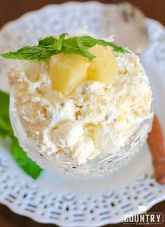 Pineapple Fluff is a no-bake dessert recipe with COOL WHIP, pineapple, marshmallows, instant pudding, pecans and coconut. So good and so easy!