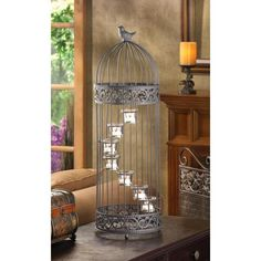 Birdcage Staircase Candle Stand (Item A little bird sits atop this darling cage that houses spiral stair-stepped tealight candle cups. Birdcage door provides easy access to the candles. diameter x high. Iron and glass. Candles not included. Candle Cups, Tealight Candle Holders, Candle Lanterns, Glass Candle, Tea Light Candles, Tea Lights, Candleholders, Candle Stands, Candle Lighting