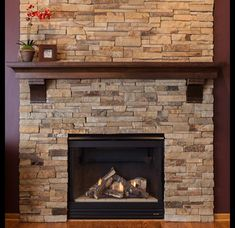 I love this stacked stone fireplace. I think the brown in the stone would look pretty as our corner fireplace in the living room. Wouldn't go all the way to the ceiling, we'd stop at the mantle, but wrap from wall to wall instead of just the front wall. Fireplace Redo, Fireplace Remodel, Fireplace Design, Fireplace Mantels, Mantel Shelf, Fireplace Ideas, Corner Stone Fireplace, Airstone Fireplace, Mantle Ideas