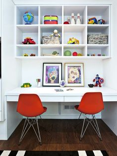 kids desk with bright red chairs