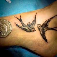 Pair of swallows Tattooed on Ankle. For more stunning and wonderful tattoo ideas and design, visit www.tattooenigma.com