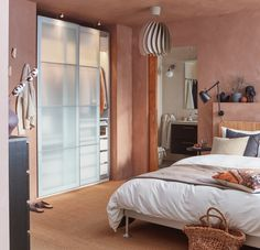 A bedroom with pink hues and natural materials - IKEA Rattan Headboard, Rattan Lamp, Bed Frame And Headboard, Malm, Dispositions Chambre, Bedroom Furniture, Bedroom Decor, Master Bedroom, Ikea Family