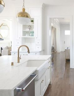 Kitchen Decor Ideas : Brass Kitchen Faucet and farmhouse sink. I love how much warmth brass can bring to a white kitchen! White kitchen with brass lighting brass faucet and brass hardware. Farmhouse Kitchen Light Fixtures, Farmhouse Faucet, Brass Kitchen Faucet, White Kitchen Decor, Kitchen Hardware, White Kitchen Cabinets, Kitchen Interior, Kitchen Design, Brass Hardware