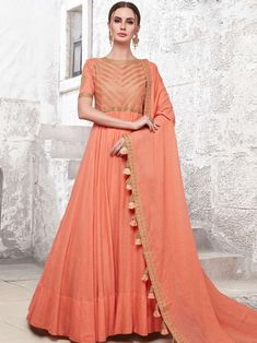 Impressive orange partywear gown online which is crafted from maslin cotton fabric with exclusive hand work also comes with cotton crepe bottom, maslin cotton dupatta. Indian Dresses Online, Indian Gowns, Gowns Online, Designer Anarkali, Designer Gowns, Orange Gown, Wedding Salwar Suits, Long Anarkali, Anarkali Dress