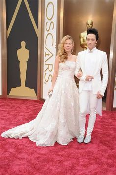 Figure skaters Tara Lipinski and Johnny Weir attend the 86th annual Academy Awards at the Dolby Theatre in Hollywood on March 2, 2014. | Gallery | Wonderwall
