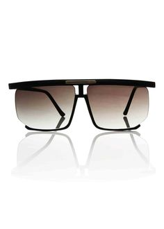 The Karl is a square acetate frame with floating lenses and retro details. This frame is constructed from black acetate with smoke lenses. Inspired by Karl Lage