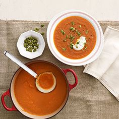 This simple spiced carrot soup gets added crunch from toasted pumpkin seeds and a mellow flavor from a drizzle of creamy yogurt.