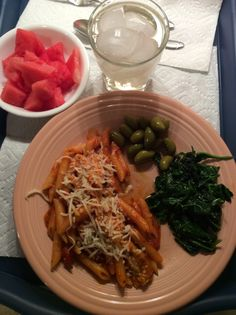 Trader Joes Penne Arrabiata sprinkled with quatro fromaggio with sautéed kale.