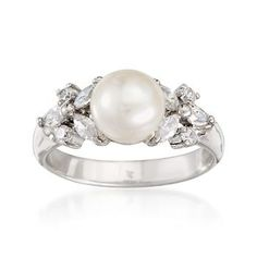 Button Pearl and Ring In Sterling Silver. This beautiful cultured button pearl and CZ ring is the essence of elegance