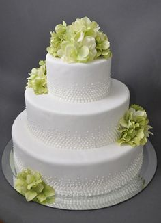 Wedding cake with luster dust and purple flowers