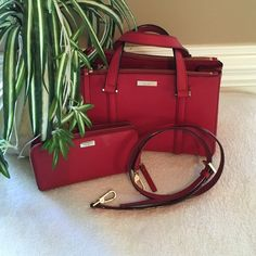 Red Authentic Kate Spade Bundle Red Leather handbag and matching wallet. Handbag has two arm straps and s shoulder strap. Snaps on each side for additional room. Interior is lined in black and white.Magnetic closure at the top with two zipper compartments. Also has a smaller zipper side compartment and two side slots for accessories. Logo on both inside and out.wallet matches. Both excellent condition.i don't want to separate. kate spade Bags Shoulder Bags