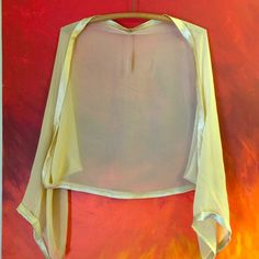 Silk Cream Shrug Elizabeth Gillett 100% silk shrug with satin edging. Really elegant and sophisticated. NWT NEVER WORN! Feel free to make an offer! I'm not fixed at this price! Elizabeth Gillett Sweaters Shrugs & Ponchos