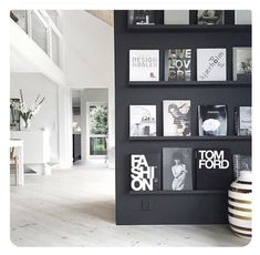 Black walls, light floors and all that light. breaks up her open plan living home in the most clever ways, including the…