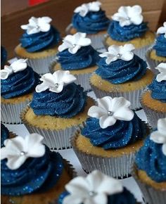 Have a big white cake and then these navy cupcakes around it. Most people appreciate having a dessert option that doesn't include giving their kids big slices of expensive cake. Beach Wedding Cupcakes, Navy Blue Wedding Cakes, Blue Beach Wedding, Fondant Wedding Cakes, Wedding Cakes With Cupcakes, Fondant Cakes, Beach Weddings, Wedding Navy, Wedding Cookies
