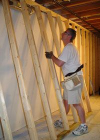 Framing an interior wall with wood studs when you add a wall in your house it will either run for Framing interior basement walls