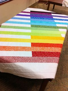 https://flic.kr/p/aW4asr | rainbow charity quilt 2 | A rainbow quilt made for the Orlando VA Hospital as part of the Orlando Modern Quilt Guild charity project for 2011.  Finished size was about 50x60.  I made up the pattern myself based on the Line Art quilt from Punk Chalk fabrics. Most everything was sourced out of fabric in my stash.